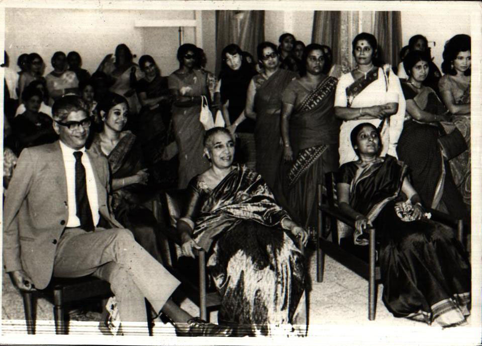 The High Commisioner and his wife with Mrs Menon (center) enjoying a performance by the members